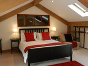 Large and spacious bedrooms feature en-suite bathrooms, Freeview television, tea and coffee making facilities and complimentary toiletries